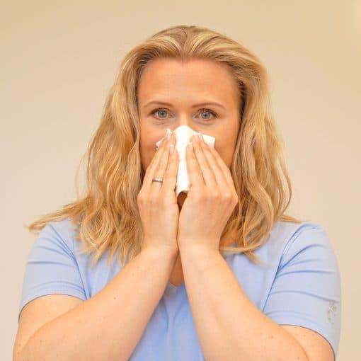 Tørking av nesen etter neseskylling